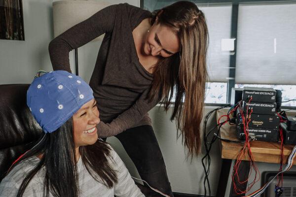 Setting up EEG cap on coaching client