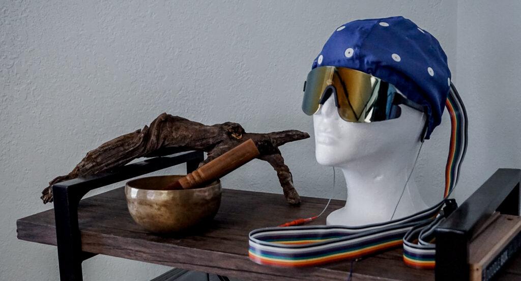 Manikin wearing EEG cap and AVE glasses